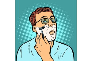 man shaving razors