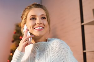 happy young blonde woman talking on