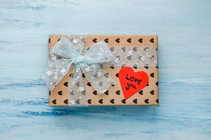 Box with a gift, tied with a ribbon