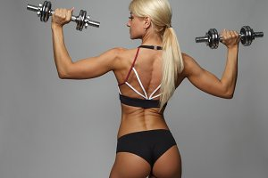 Athletic beautiful woman doing