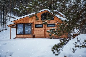 Winter holiday house in forest.