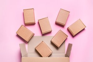 Falling cardboard boxes on pink back
