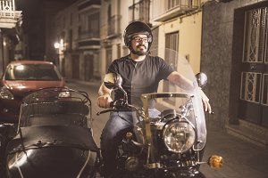 Young biker on moto