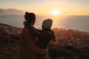 Romantic couple admiring the sunset
