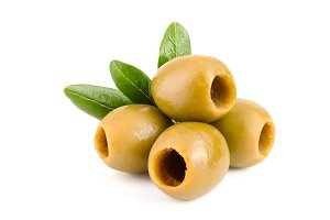 Green olives with leaves isolated on
