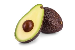 avocado and half isolated on white