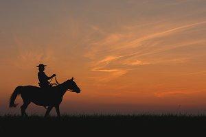 Cowboy riding horse, wild west