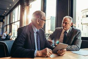 Senior businessman listening
