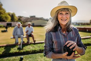 Close up of a woman playing boules