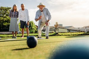 Group of senior people playing boule
