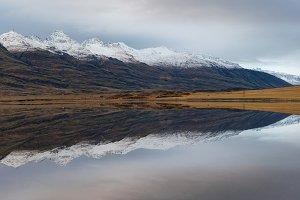 Mountain reflections in Berufjordur