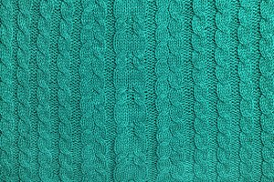 Turquoise colored knitted background