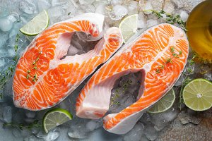 Two raw fresh salmon or trout steaks