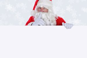 Santa Claus with blank sign Shhh