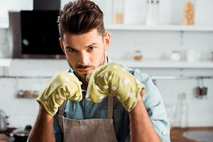 handsome young man in apron and poth
