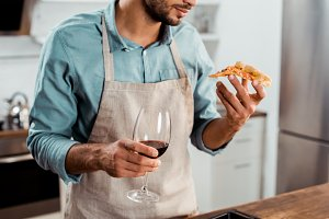 cropped shot of man in apron holding