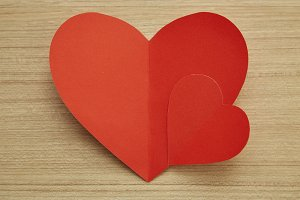 Valentine's day red paper heart on w