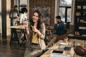 smiling casual businesswoman holding