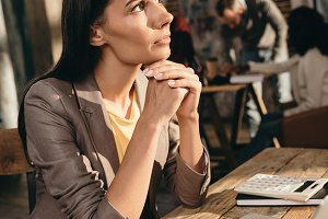 pensive business woman sitting at de