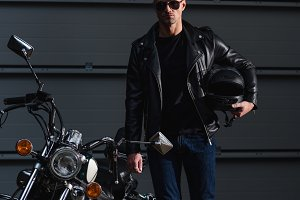 stylish biker in black sunglasses an