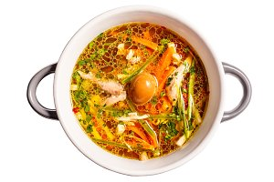 Rooster soup with smoked quail egg