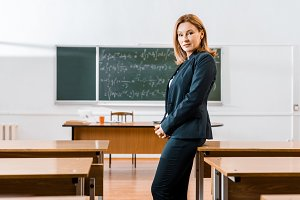beautiful serious female teacher in