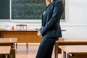 beautiful female teacher in formal w