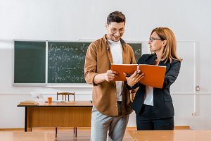 female teacher helping male student