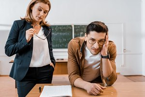 dissatisfied female teacher and male