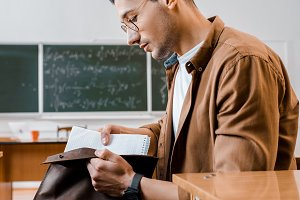 concentrated male student in glasses