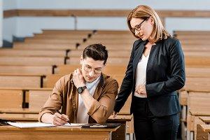 female university teacher looking at