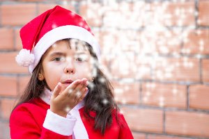 little girl dressed as santa claus b