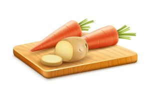 Organic vegetables carrots potatoes cut on wooden board