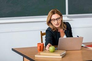 beautiful female teacher in glasses