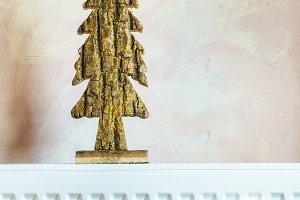Shiny Christmas tree. Gold colour