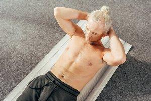 high angle view of shirtless man doi