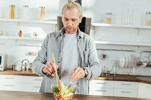 handsome adult man cooking vegetable