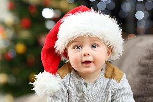 Portrait of a baby wearing santa hat