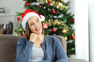 Happy woman thinking on christmas
