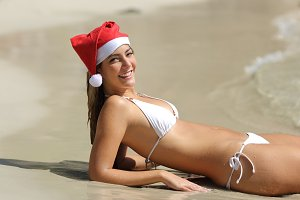 Happy woman on the beach on chistmas