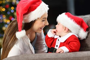 Happy mother and baby in christmas
