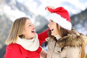 Happy friends joking on christmas