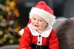 Cute baby wearing santa disguise