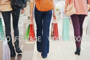 Low shot of female shoppers walking