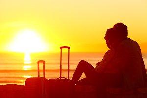 Travelers watching sunset