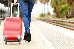 Traveler legs walking carrying bag