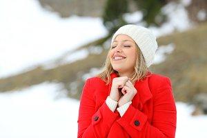 Woman enjoying winter in the mountai