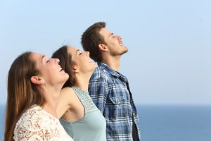 Profile of three friends breathing