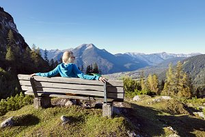 Woman on bench in Alps