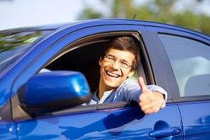 Guy in car with thumb up